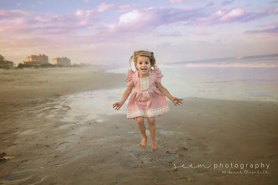 SEEM photography Child Jumping at the Beach