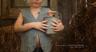 SEEM photography Child Holding Pail