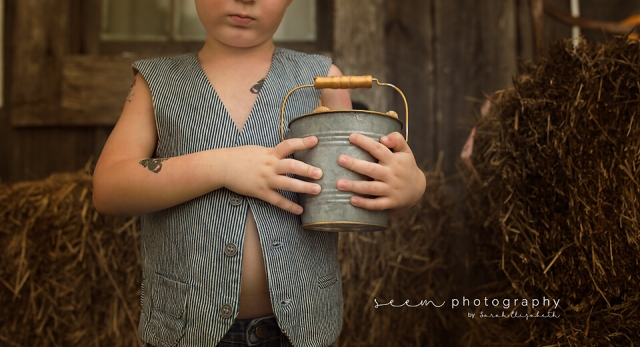 SEEM photography Child Holding Pail